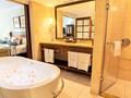 La salle de bain de la chambre Deluxe
