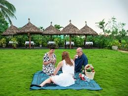Pique niquez dans le jardin verdoyant de l'Hoi An Ancient House Village