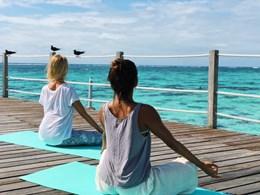 Yoga face à l'océan
