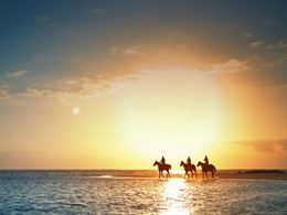 Balade à cheval sur la plage