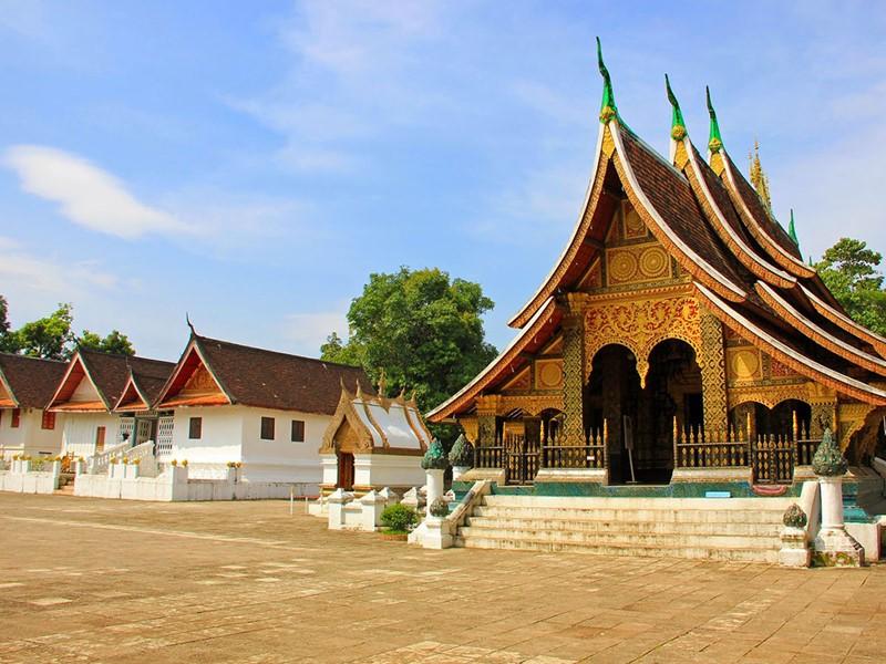 Direction le plus beau temple de la ville; Le Wat Xieng Thong