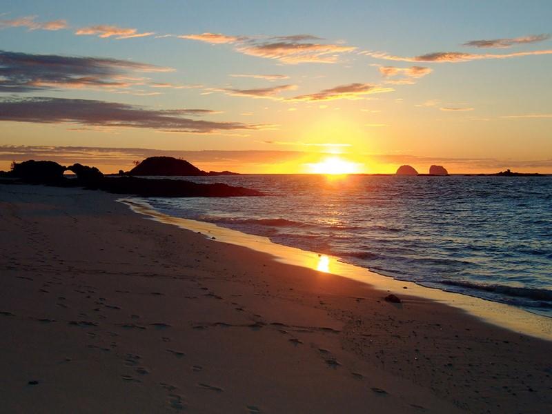 Contemplez un magnifique coucher de soleil depuis la plage du Constance