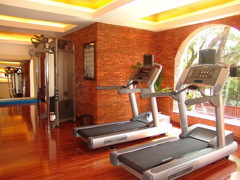 La salle de sport de l'hôtel Dhara Dhevi situé à Chiang Mai