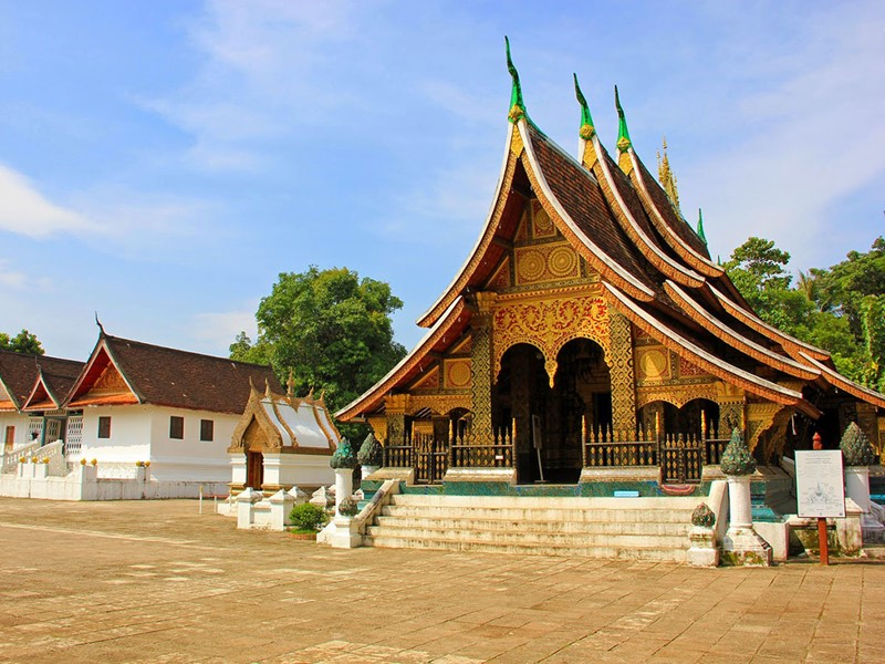 Direction le plus beau temple de la ville; Le Wat Xieng Thong