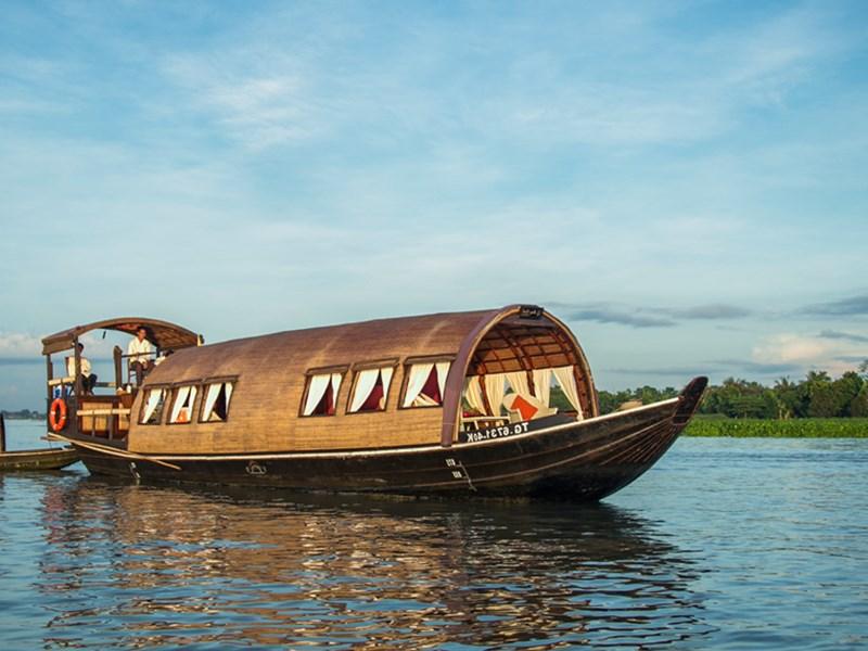 Embarquerez à bord du Sampan Song Xanh